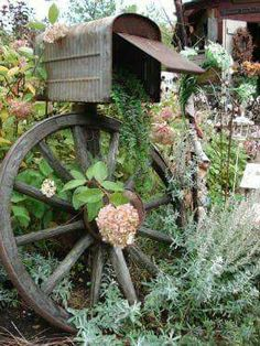 Have to do this with my mother's old mailbox. Old Tin Shed, Ontario, Summer Gardens. I need this gorgeous mailbox with flowerbeds! Rustic Gardens, Outdoor Gardens, Jardin Decor, Tin Shed, Down On The Farm, Garden Inspiration, Garden Ideas, Garden Boxes, Garden Planters