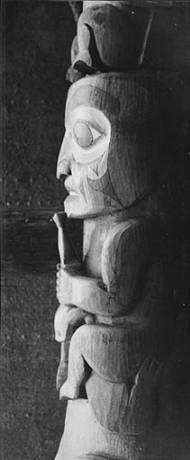 Tlingit totem pole, partial side view with figure, Seattle, Washington, June 1940. :: American Indians of the Pacific Northwest