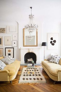 Pale yellows are really making quite the statement this year. Love the warmth in this space!