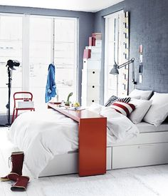 Great red, white and blue bedroom. put the tray on a roller, so you don't have to get outa bed when you are finished with. may be it is already.