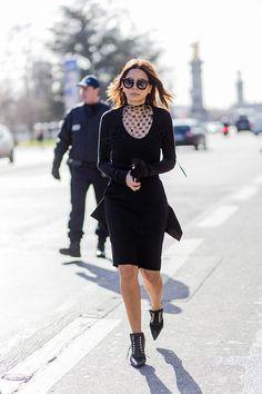 Christine Centenera wearing a black dress and sunglasses outside Maison Margiela during the Paris Fashion Week Womenswear Fall/Winter 2016/2017 on...