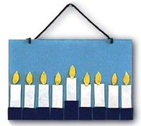 "Our holiday wall hanging makes menorah lighting easy and safe for even the youngest child. On the first night of Hanukkah, ""light"" the shammes and then the candle to the far right. Each night add a new flame, always starting"