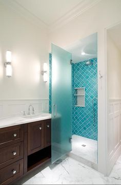 Turquoise blue arabesque tiles and carrera marble floor