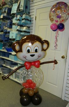 Mischievous Monkey with balloon hearts in his belly holding the Monkey Love Bubble balloon.  www.itspartytimeandrentals.com