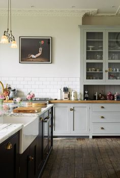 kitchen white subway tile painted shaker cabinets.