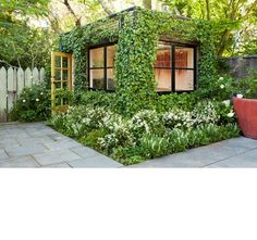 A camouflaged tiny garden house/shed office....