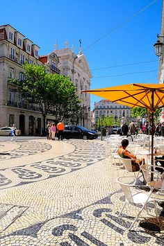 Chiado. Lisbon, Portugal. I spent one whole afternoon watching men hand-pound these tiles to repair a street in Lisbon (though not the one pictured here). Fascinating! And such beauty....