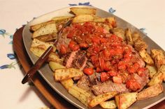 Steak and  tomatoes with roast potatoes. This is a meat and potatoes meal you won't soon forget.