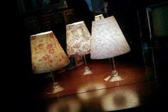 Mini lamp made with a wine glass, scrapbook paper, and a tea light candle.