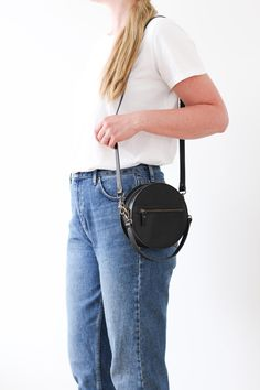 BOMBOM round handbag featuring a classic outfit for inspiration. You can use it as a messenger across your body or carry it in the hand. Big enough to carry your wallet, phone, make-up, keys or glasses. Handmade from vegetal tanned leather.