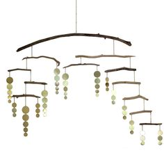 - Driftwood length ranges from 6 to 30 inches and is approximately 1/4 inch thick. - Flat brass discs range between 1 to 2 inches. Pendant lengths range from 5-10 inches. - The mobile hangs from a 12