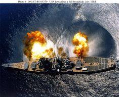USS Iowa firing a full 9-gun 16-inch broadside.