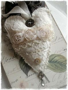 Fabric Heart - Clever use of a button at the top to cover the attached edge of the loop of ribbon.
