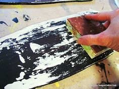 paint with scrap of wood in layers to create weathered/worn look