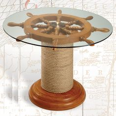 "Robins dockside shop solid hardwood ship's wheel and rope stand table with 25"" Ship's Wheel under a tempered glass top.   Size: 26.5x18"" H Price: $339.95"