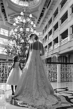 A precious moment between a bride and her flower girl at Disney's Grand Floridian Resort