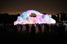 interactive public installation. burble london - 1000 XL helium balloons with microcontrolled LEDS wired together.