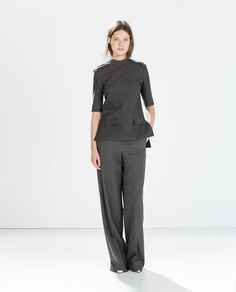 Image 1 of TOP WITH DETAILING ON THE SHOULDER from Zara