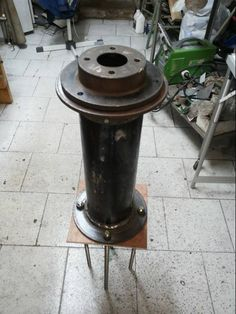 Steel pier pedestal constructed from scrap brake discs and a section of mild steel drain tube. The pedistal was used to anchor the AVX mount of my Celestron OTA. It was itself rooted inside a concrete column by 4 stainless steel thread sections buried there.