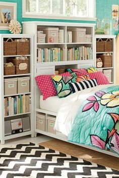 Pretty colors! Loving the shelving system, the colorful bedding and that chevron rug!