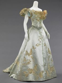 Ball Gown, 1898 - House of Worth - made from a very special fabric which was woven à la disposition to fit the shape and dimensions of the skirt so that the butterflies flutter upward from the hem and, being graduated in size, seem to disappear in the distance. (text from website, http://fashioninhistory.tumblr.com)