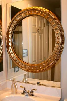 mirror frame in bathroom.  I would like a round one on my ginormous mirror & a square one on dh's