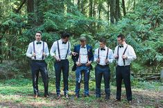 groomsmen in bow ties and suspendes