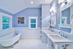 Like the bead board in the bathroom with the hex floor.  Like the pedestal sinks and medicine cabinets.  Like the clean look of bathroom.