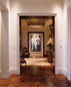 The framed ladies at the end of the corridor provide this space elegance and intrigue. I can't imagine a space without art. Donna Livingston