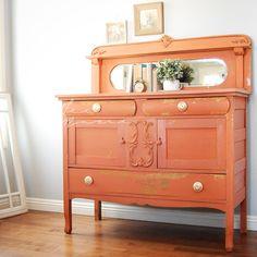Bold orange antique buffet with goal hardware