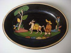 Vintage 1930s black Tlaquepaque plate.    http://www.mexicana-nirvana.com/catalog/item/7774067/9983262.htm