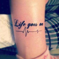 Life goes on, heartbeat tattoo.