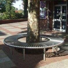 The Orion Stainless Steel Tree Bench is an elegant low maintenance circular seating solution, a popular choice for various different public space. Cycle Shelters, Cycle Stand, Outdoor Seating, Outdoor Decor, Tree Bench, 316 Stainless Steel, Sundial, Street Furniture, Canopy