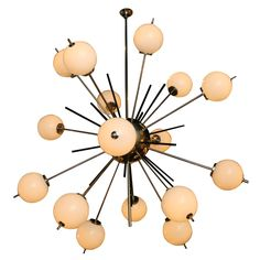 Sixteen-arm Chandelier by Gino Sarfatti, Italian 1950s | From a unique collection of antique and modern chandeliers and pendants  at https://www.1stdibs.com/furniture/lighting/chandeliers-pendant-lights/