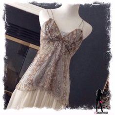 """EUC Elie Tahari Silk Paisley SpaghettiStrap Tank S Worn one time. Lovely soft and feminine 100% silk tank top with delicate spaghetti straps. The straps have been shortened but can be let out if needed. The top is a light blue and beige paisley design. Measures 32"""" around underarm, 28"""" around waist and 18.5"""" in length. Priced to reflect alteration to straps and pre-loved condition. Elie Tahari Tops Tank Tops"""