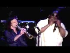 Kenny G in concert duet with Stevie Wonder performing the popular Besame Mucho