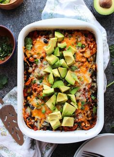 Spiralized Sweet Potato Enchilada Casserole loaded with veggies, black beans and doused in a simple homemade enchilada sauce | Gluten Free + Vegetarian