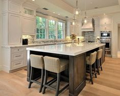 There is no question that designing a new kitchen layout for a large kitchen is much easier than for a small kitchen. A large kitchen provides a designer with adequate space to incorporate many convenient kitchen accessories such as wall ovens, raised. Kitchen With Big Island, Kitchen Island Decor, Kitchen Redo, New Kitchen, Kitchen Islands, Kitchen Ideas, Kitchen Island Seating, Long Kitchen, Awesome Kitchen