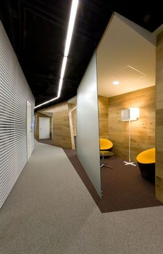 The small matte glass as a partition to make a small room for all director and they paint the ceiling to black to cover all the pipe #officedesign