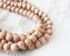 Natural Pink Wood Beads Environment Safe Round Beads Untreated Rosewood 8mm 16 inches strand by 615supply on Etsy https://www.etsy.com/listing/246794517/natural-pink-wood-beads-environment-safe