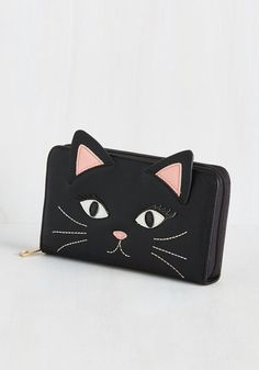 Cat Got Your Funds Clutch  Never has an accessory left you speechless - until now! This black, vegan faux-leather clutch has all the pocketry of the perfect wallet, and with extra space to spare! Glammed up with glossy eyes and lashes, this kitty cardholder opens up a whole mew world of quirky style. The post  Cat Got Your Funds Clutch  appeared first on  Vintage & Curvy .  http://www.vintageandcurvy.com/product/cat-got-your-funds-clutch