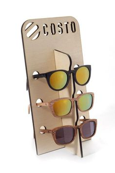 We recently made this laser cut plywood sunglasses stand for Costo to display…