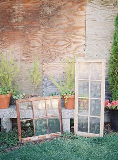 vintage windows used to display seating assignments |  Photography: Michael Radford Photography - michaelradfordphotography.com