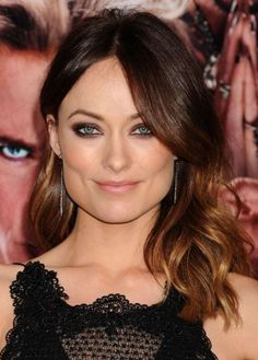 Actress Olivia Wilde looks stunning with her dark golden brown tresses. She sports a trendy ombre fade from chestnut to golden brown, with warm hues that brighten her complexion. Golden brown is a great hair color choice if you're looking a lighter, more vibrant alternative to dark or medium brown.