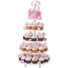 Initial Announcement Cake and Cupcakes - Proudly display the wedded couple's monogram while serving trendy cupcakes at the reception. When stacked together on the Towering Tiers Cake and Dessert Stand, the cake and cupcakes make quite an impression! Wilton Cakes, Cupcake Cakes, Cupcake Tier, Cupcake Ideas, Cake Stand Display, Cupcake Display, Cake Stands, Rose Icing, Happiness
