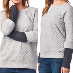 💠💠The SANDEE quilted top - GREY 🎉️️HP 11/18🎉How fun is this light grey quilted top with dark grey arm cuffs? QUILTED TOP 96% POLY 4% SPAN MADE IN USA ‼️NO TRADE‼️NO FURTHER DISCOUNT! Bellanblue Sweaters