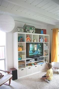 When Your Living Room is Your Play Room.  I like this concept but find it too open, showing too many toys and stuff.  It would need to have baskets at least the halfway point vertically for me to go for it with out living room.