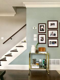 Benjamin Moore paints: Accent wall - Raindance w/Revere Pewter & Trims & Mouldings: Acadia White