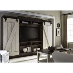 Unique styling with stick built design and hardware accents. Casual rustic with a contemporary feel. Today's interior style is highlighted in an entertainment wall unit.  Lancaster features sliding barn style doors.