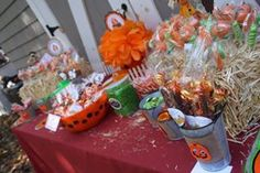 Candy corner-hay bales filled with lollipop and cake pops; orange and green candy; chocolate covered Oreos to look like pumpkins; chocolate covered pretzels